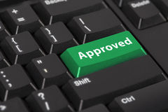 Keyboard with the word approved on green button. Stock Photography