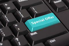 Keyboard with the word Special offer on blue button. Stock Images