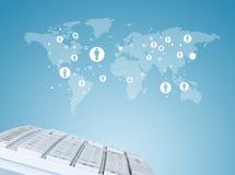 Keyboard on world map background with symbols Royalty Free Stock Image