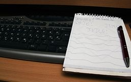 Keyboard and writing block. stock photography