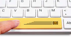 Keyboard yellow express delivery package. Stock Photo