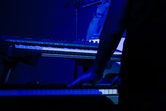 Keyboarder. A musician on stage playing Keyboard Stock Photos