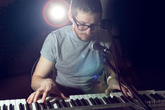 Keyboarder is playing and singing. Stock Images