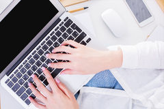 Keyboarding female hands Stock Images