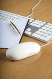 Keyboards, mouse and notebook Stock Photography