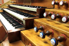Keyboards of organ. Keyboards and pedals of church organs Royalty Free Stock Photo