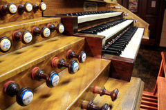 Keyboards of organ. Keyboards and pedals of church organs Royalty Free Stock Photos