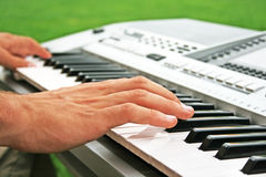 Keyboards  player. Musician playing on keyboards, horizontal picture Royalty Free Stock Photography