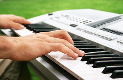 Keyboards  player. Musician playing on keyboards, horizontal picture Stock Image