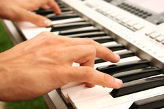 Keyboards  player. Musician playing on keyboards, closeup picture Royalty Free Stock Photography