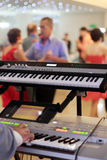 Keyboards player at party Stock Image