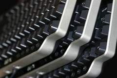 Keyboards Three. Three black and grey keyboards are stacked at an angle Royalty Free Stock Images