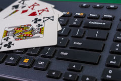 Keyboord and four kings (online gambling) Stock Images