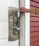 Keycard access to holtel. Hand inserting a keycard in motel door lock Stock Image