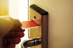 Keycard Door Lock. Person Unlocking Keycard Door Lock royalty free stock photos