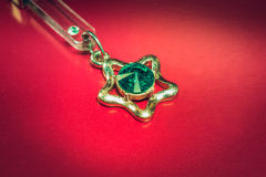 Keychain with emerald Royalty Free Stock Images