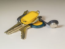 Keychain with keys on light background Stock Image