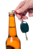 Keychain - Opener. Hand opens a bottle of beer keychain car key. Isolated on white background Royalty Free Stock Photos