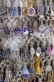 Keychains, hamsa - traditionele palm-vormige amulet Stock Fotografie
