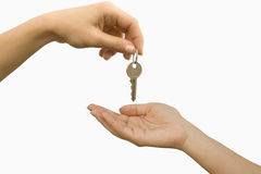 KeyHand. The key in one hand transfers it in another Stock Image