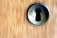 Keyhole. Keyhold on a wooden background stock photos