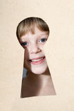 Keyhole. An image of a girl looking into a keyhole Stock Photo