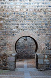 Keyhole arch. In stone wall stock photography