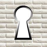 Keyhole on a brick wall Royalty Free Stock Image