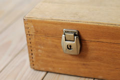 Keyhole. Corner of the old wooden suitcase Stock Photos