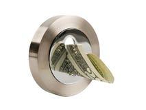 Keyhole and dollar. Round keyhole and dollar banknote isolated on white background Stock Photos