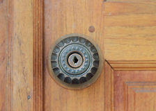 Keyhole door handle on brown wood door Stock Photos