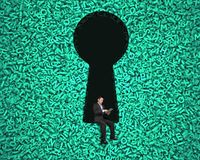 Keyhole on green big data background with businessman sitting royalty free stock photo
