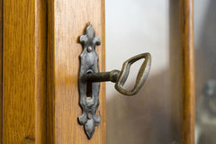Keyhole with key Stock Images