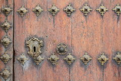Keyhole. A large keyhole on an old door Stock Photos