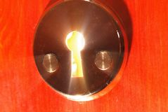 Keyhole with light. Coming from it Stock Photo