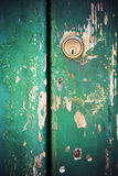 Keyhole lock on peeling painted green door Stock Photography