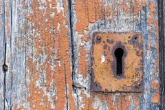 Keyhole. Old neglected keyhole in wooden door stock photos