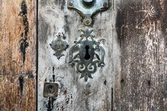 Keyhole over aged gray and brown old wood Stock Images