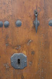 Keyhole in a  rustic door. Royalty Free Stock Images