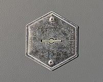 Keyhole. Steel keyhole on the gray metal door stock photos