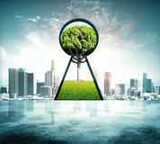Keyhole with tree view. Abstract keyhole with green tree view on city background Royalty Free Stock Photos