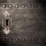 Keyhole. Vintage keyhole in old iron doors, abstract background Stock Photo