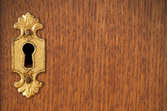 Keyhole on wooden background Stock Images