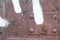 Keyholes in the metal doors of garages on the street. stock photos