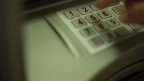 Keying in PIN at ATM stock video