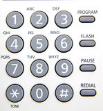 Keypad. Close up of a telephone  numerical keypad with gray buttons Royalty Free Stock Photography