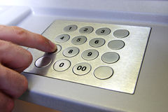 Keypad. Atm keypad and business man hand Royalty Free Stock Images