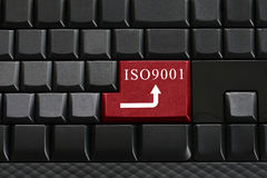 Keypad of black keyboard and have text ISO9001 on enter button. Stock Photos