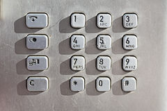 Keypad buttons on a public phone Stock Photo