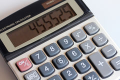 Keypad calculator with computing. Is on the table Stock Photo